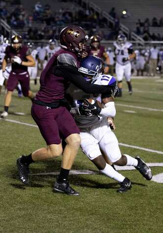 Magnolia West defensive back Caden Robertson (4) grabs onto Lufkin wide receiver Journie Thomas (17) during the fourth quarter of a District 8-5A (Div. I) play at Mustang Stadium in Magnolia, Friday, Oct. 9, 2020. Photo: Gustavo Huerta, Staff Photographer / 2020 © Houston Chronicle