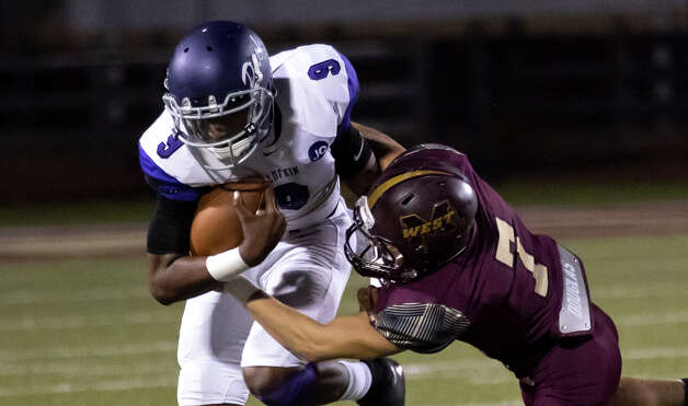 Magnolia West defensive back Cody Costello (7) tackles Lufkin quarterback Jordan Moore (9) during the third quarter of a District 8-5A (Div. I) play at Mustang Stadium in Magnolia, Friday, Oct. 9, 2020. Photo: Gustavo Huerta, Staff Photographer / 2020 © Houston Chronicle