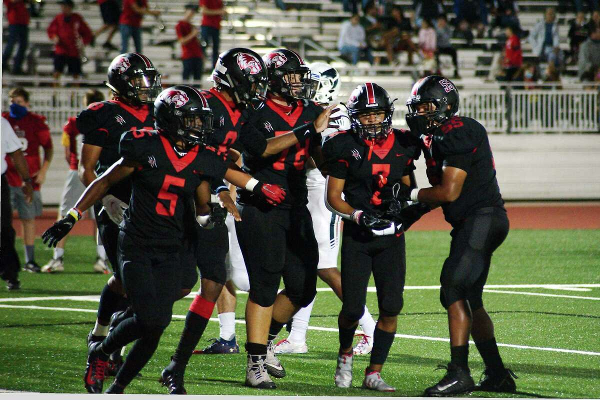 Clear Brook's Jaysen Price (7) is swarmed by teammates after scoring a touchdown against Clear Lake Friday, Oct. 9 at Challenger Columbia Stadium.