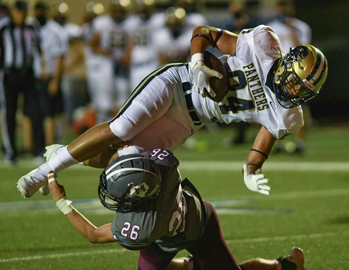 O'Connor tight end Isaiah Gonzales bowls over Marshall's Jacob Childers to score one of his two receiving touchdowns.