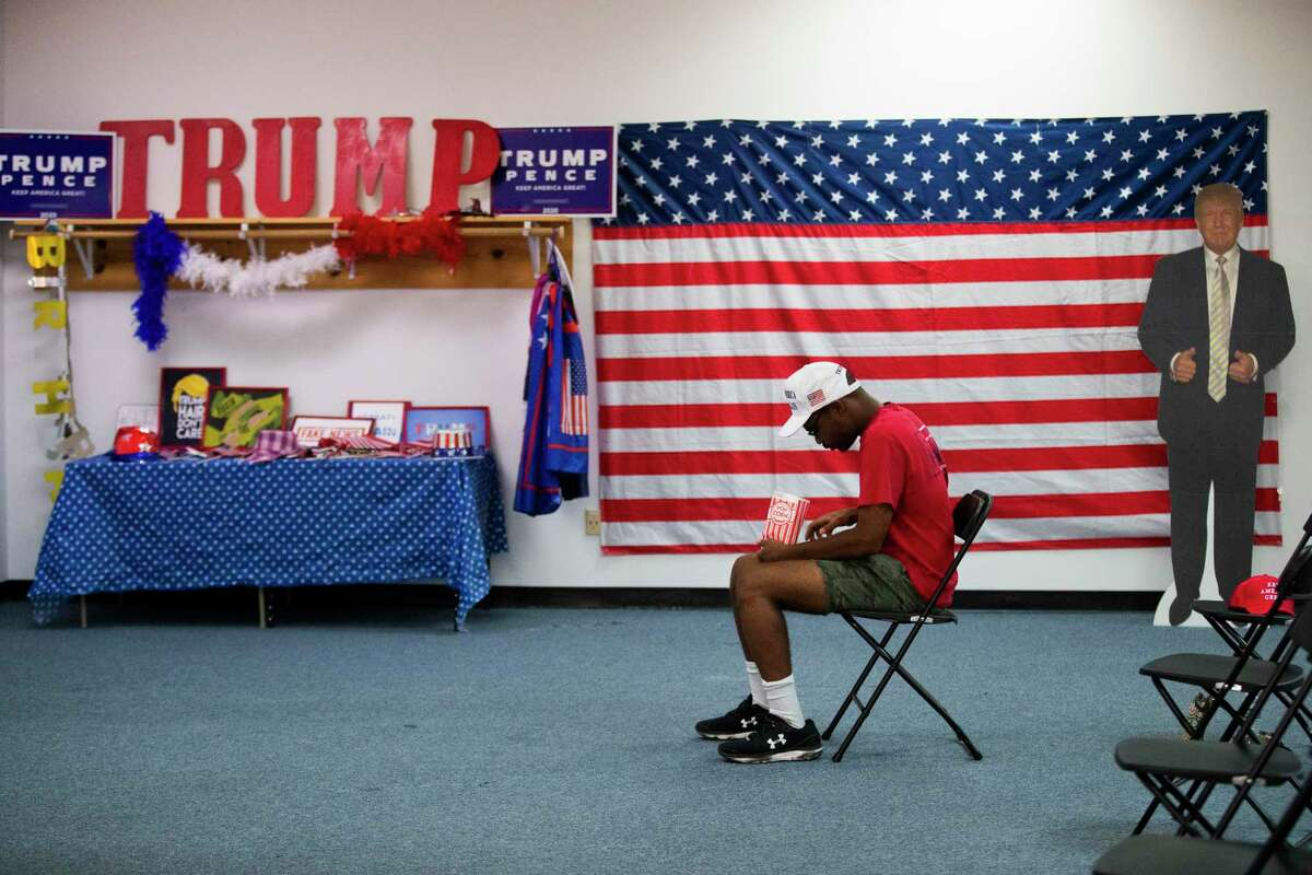 Tamon Hamlett, 19, a political sciences student at the University of Houston attends a Republican meeting on Tuesday, Aug. 18, in Katy in support of the re-election of President Donald Trump.