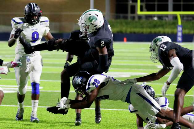 Spring wide receiver Aldyn Bradley (2) jumps to avoid the tackle by Dekaney receiver/defender Troy Benford (20) during the second half of a high school football game Friday, Oct. 9, 2020 at Planet Ford Stadium in Spring, TX. Photo: Michael Wyke, Contributor / © 2020 Houston Chronicle