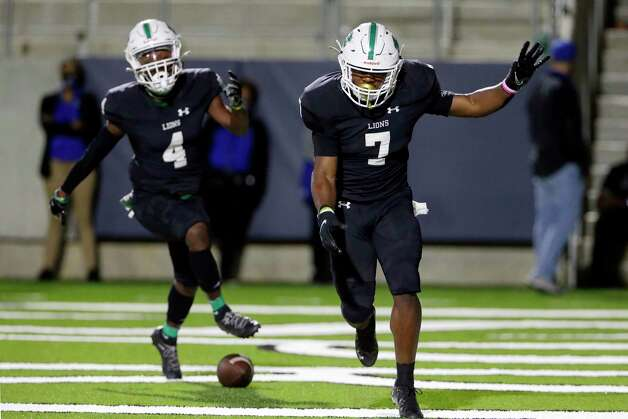 Spring wide receiver Caleb Jones (4) and running back Myron Carter (7) celebrate Carter's touchdown during the second half of a high school football game against the Dekaney Wildcats Friday, Oct. 9, 2020 at Planet Ford Stadium in Spring, TX. Photo: Michael Wyke, Contributor / © 2020 Houston Chronicle