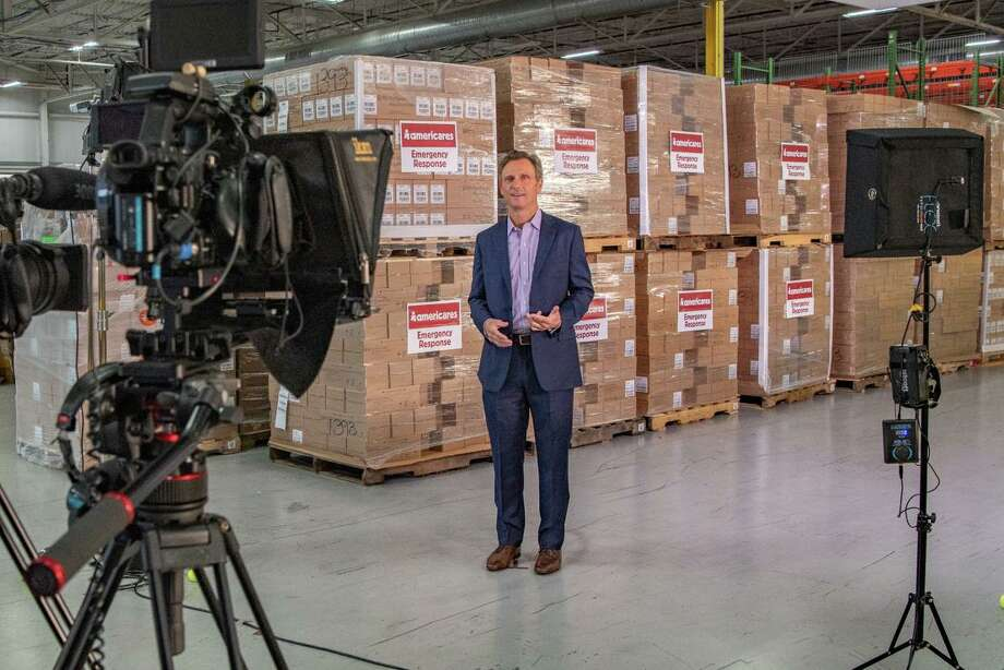 Actor Tony Goldwyn co-hosts the Americares Airlift Benefit Livestream at the Americares distribution center in Stamford on Oct. 3. Photo: Photo Courtesy Of Americares /