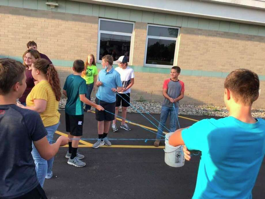 Ubly FFA members practice team building playing the bucket game. (Submitted Photo)