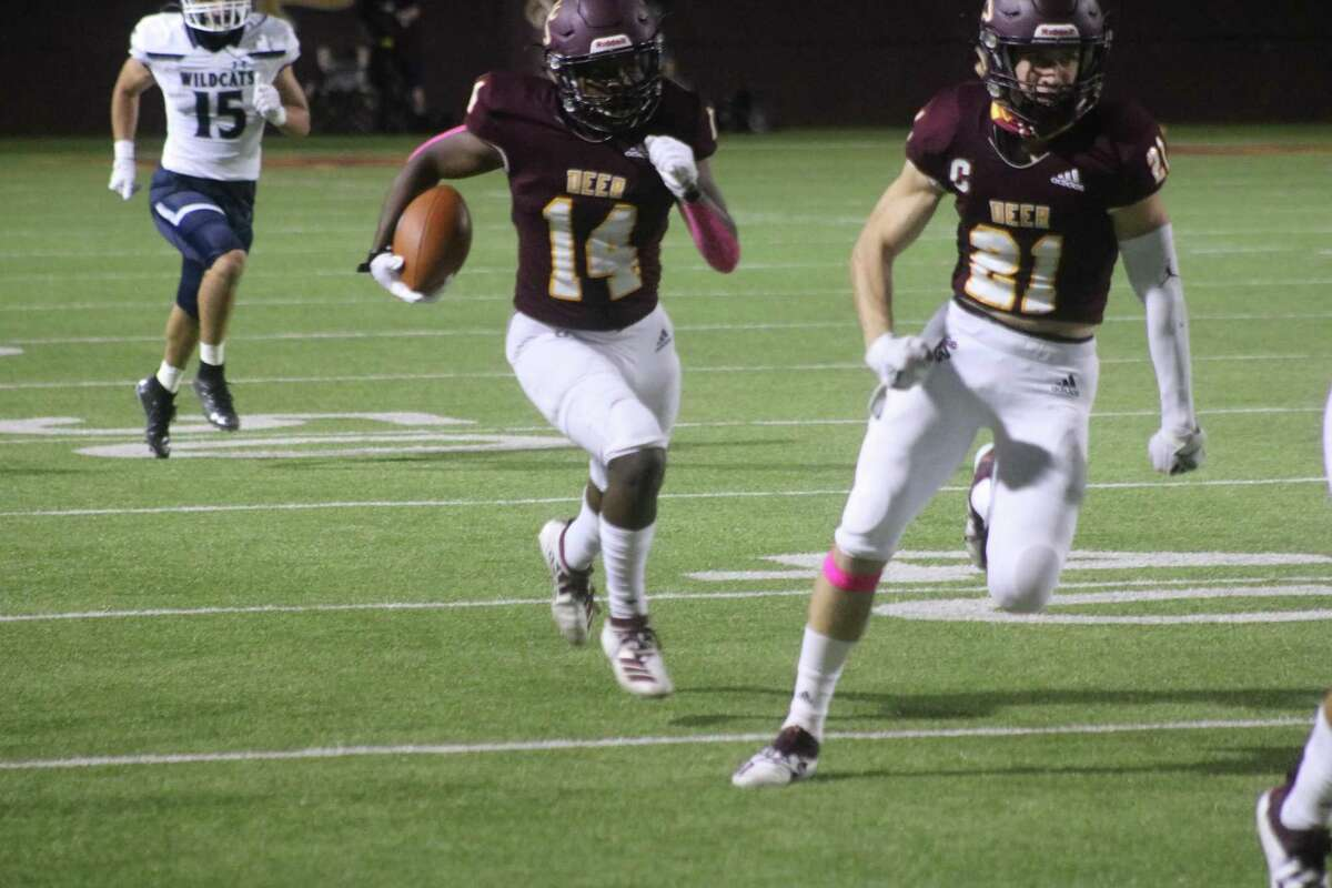 With Zach Frazee providing interference, Deer Park's Tudi Gustave returns an interception that led to the team's second score and a 22-14 deficit Friday night.