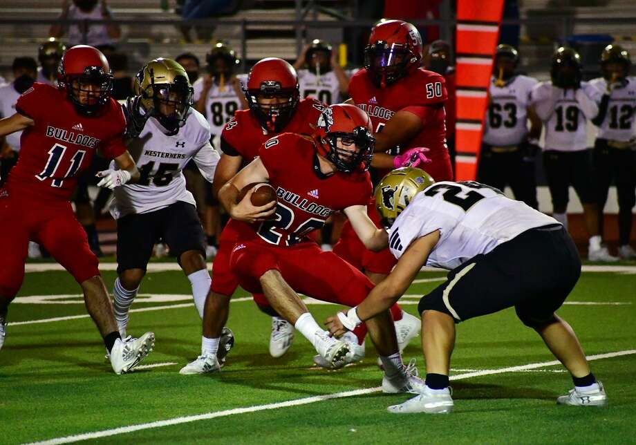 Plainview's Josiah Malcom fights off a Lubbock tackler during a return on one of his two interceptions during their non-district high school football game on Friday, Oct. 9, 2020 in Greg Sherwood Memorial Bulldog Stadium. Photo: Nathan Giese/Planview Herald