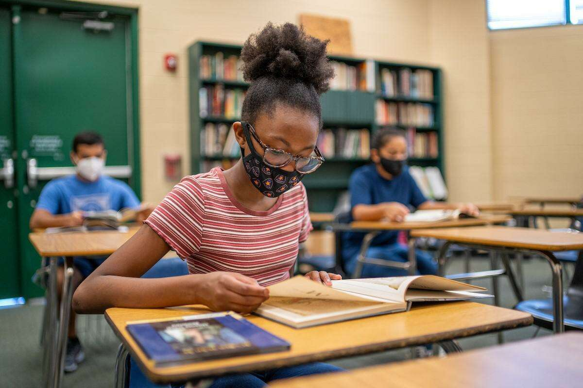 Spring ISD students practice social distancing and wear protective masks while learning in the classroom.