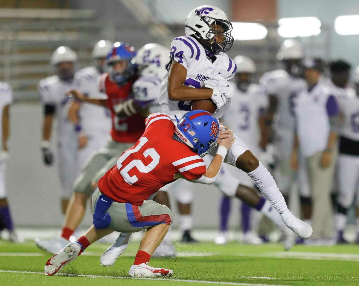 Humble wide receiver Luther Stroder, Jr (84) catches a punt as Oak Ridge cornerback Salde Wright-Gonzales (12) defends during the third quarter of a non-district high school football game at Woodforest Bank Stadium, Thursday, Oct. 8, 2020, in Shenandoah.