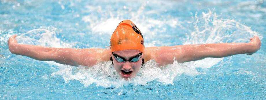 Hannah Seward of Ridgefield swims to a first-place finish in the 100-yard butterfly in the CIAC Class LL Championship at Wesleyan University in Middletown on Nov. 19, 2019. Photo: Arnold Gold / Hearst Connecticut Media