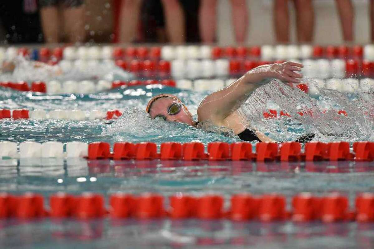 Rylie Giles competes in the 500-yard freestyle during the FCIAC girls swimming championship on Nov 5, 2019, at Greenwich High School.