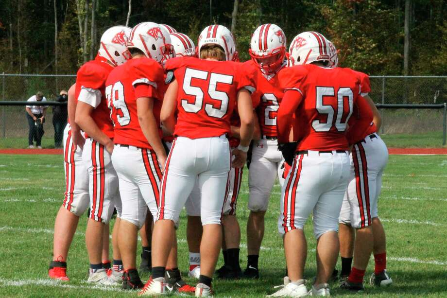 The Huskies huddle up between plays during their previous victory over Cheboygan on Sept. 26. (File photo)