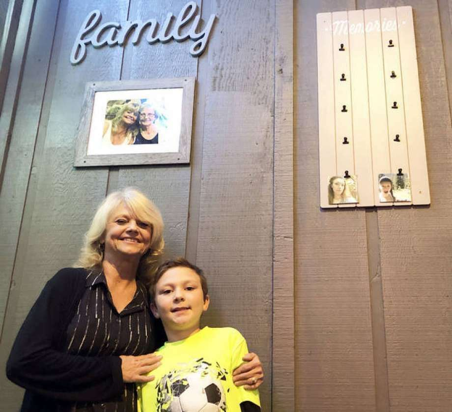 The Back Bar owner Marion Gilson stands with her grandson, Zach, at the business's soft opening in December 2018. The business, located at 228 N. Main St. in Edwardsville, is welcoming Friday's announcement of the return of Phase 4 of the Restore Illinois Plan, which includes a return to indoor drinking and dining with a limited capacity. Photo: Intelligencer File Photo