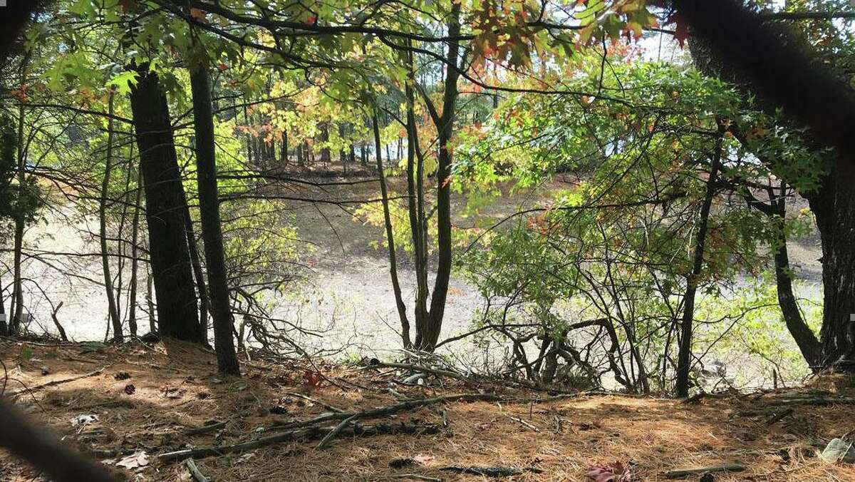 The dry bed of the North Stamford Reservoir on Lakeside Drive bakes in the sun Friday, Oct. 9, 2020.