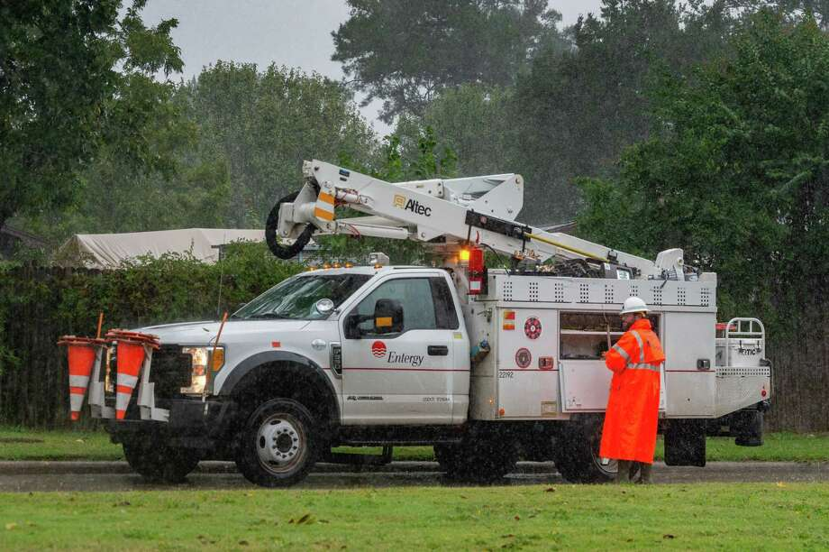 An Entergy employee works in the pouring rain on Phelan Boulevard on Friday afternoon. With Hurricane Delta churning out in the Gulf, Southeast Texans prepare for another possible storm situation. Photo made on October 09, 2020. Fran Ruchalski/The Enterprise Photo: Fran Ruchalski, The Enterprise / The Enterprise / © 2020 The Beaumont Enterprise
