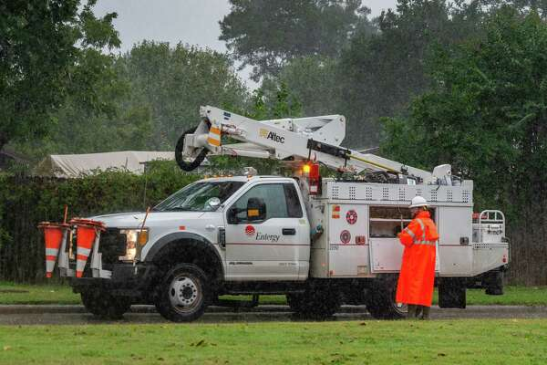 An Entergy employee works in the pouring rain on Phelan Boulevard on Friday afternoon. With Hurricane Delta churning out in the Gulf, Southeast Texans prepare for another possible storm situation. Photo made on October 09, 2020. Fran Ruchalski/The Enterprise