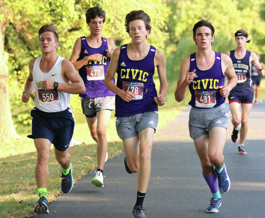 Roxana's Matthew Olbert (left) runs with CM's Trevor Kroeschel (477), Lucas Naugle (478) and Evan Zobrist (481) in the opening mile of the Madison County small-schools boys cross country meet on Tuesday at Belk Park in Wood River. CM won the boys meet, while Father McGivney's Tyler Guthrie won the race. Photo: Greg Shashack / The Telegraph