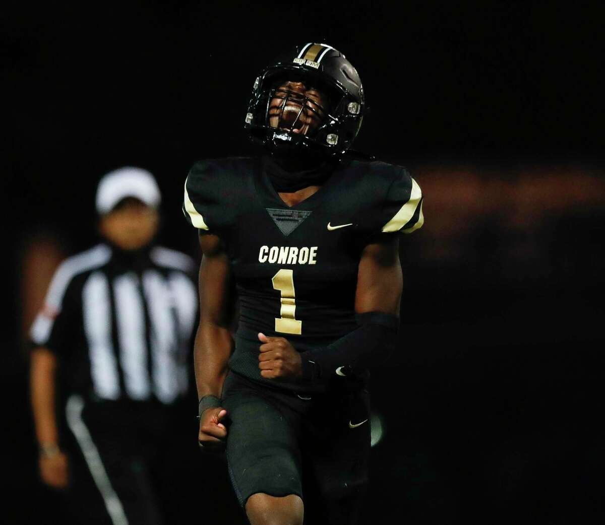 Conroe quarterback Jalen Williams (1), shown here last week against Kingwood, threw for two touchdowns and rushed for another against Summer Creek on Friday night.