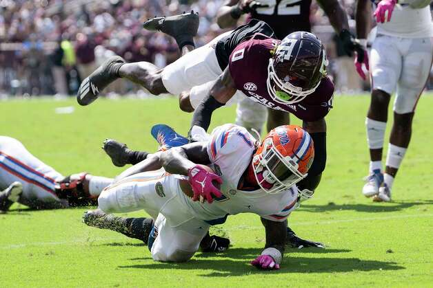 Florida wide receiver Kadarius Toney (1) is stopped just short of the goal line by Texas A&M defensive back Myles Jones (0) during the second quarter of an NCAA college football game, Saturday, Oct. 10, 2020, in College Station, Texas. (AP Photo/Sam Craft) Photo: Sam Craft, Associated Press / Copyright 2020 The Associated Press. All rights reserved.