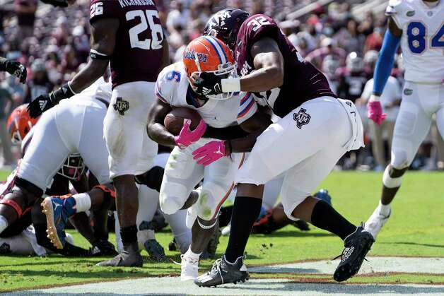 Florida running back Nay'Quan Wright (6) fights his way past Texas A&M linebacker Andre White Jr. (32) for a touchdown during the second quarter of an NCAA college football game, Saturday, Oct. 10, 2020, in College Station, Texas. (AP Photo/Sam Craft) Photo: Sam Craft, Associated Press / Copyright 2020 The Associated Press. All rights reserved.