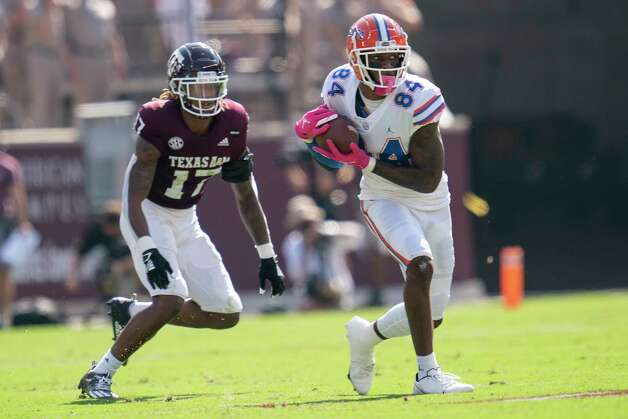 Florida tight end Kyle Pitts (84) catches a pass as Texas A&M defensive back Jaylon Jones (17) defends during the first quarter of an NCAA college football game, Saturday, Oct. 10, 2020. in College Station, Texas. (AP Photo/Sam Craft) Photo: Sam Craft, Associated Press / Copyright 2020 The Associated Press. All rights reserved.
