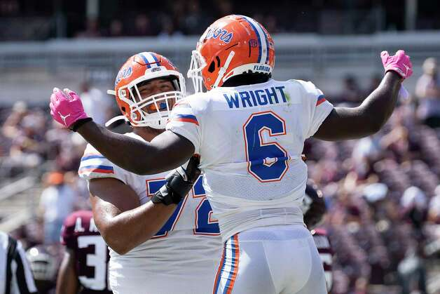 Florida running back Nay'Quan Wright (6) celebrates with teammate Stone Forsythe (72) after a short touchdown run against Texas A&M during the second quarter of an NCAA college football game, Saturday, Oct. 10, 2020, in College Station, Texas. (AP Photo/Sam Craft) Photo: Sam Craft, Associated Press / Copyright 2020 The Associated Press. All rights reserved.