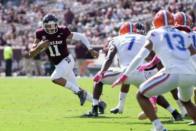 Texas A&M quarterback Kellen Mond (11) looks to run against Florida linebacker Jeremiah Moon (7) during the first quarter of an NCAA college football game, Saturday, Oct. 10, 2020. in College Station, Texas. (AP Photo/Sam Craft) Photo: Sam Craft, Associated Press / Copyright 2020 The Associated Press. All rights reserved.