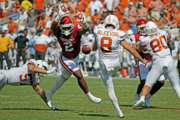 Oklahoma linebacker David Ugwoegbu (2) blocks a punt by Texas punter Ryan Bujcevski (8) during an NCAA college football game in Dallas, Saturday, Oct. 10, 2020. (AP Photo/Michael Ainsworth) Photo: Michael Ainsworth, Associated Press / Copyright 2020 The Associated Press. All rights reserved.