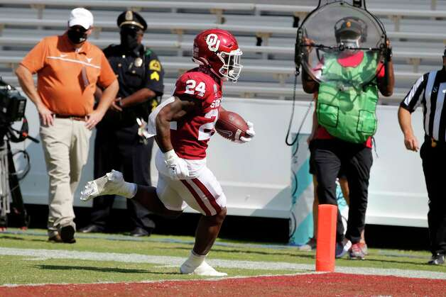 Oklahoma running back Marcus Major (24) scores a rushing touchdown against Texas during an NCAA college football game in Dallas, Saturday, Oct. 10, 2020. (AP Photo/Michael Ainsworth) Photo: Michael Ainsworth, Associated Press / Copyright 2020 The Associated Press. All rights reserved.