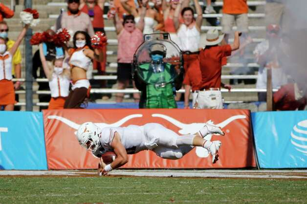 Texas quarterback Sam Ehlinger (11) scores a touchdown against Oklahoma during an NCAA college football game in Dallas, Saturday, Oct. 10, 2020. (AP Photo/Michael Ainsworth) Photo: Michael Ainsworth, Associated Press / Copyright 2020 The Associated Press. All rights reserved.