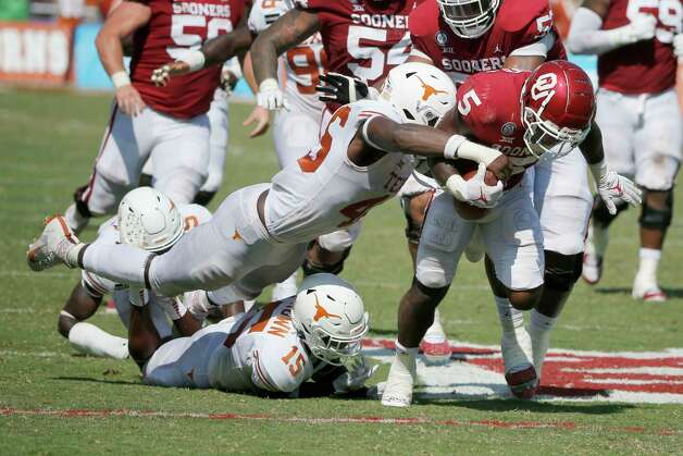 Texas linebacker Joseph Ossai (46) forces a fumble by Oklahoma running back T.J. Pledger (5) during an NCAA college football game in Dallas, Saturday, Oct. 10, 2020. (AP Photo/Michael Ainsworth) Photo: Michael Ainsworth, Associated Press / Copyright 2020 The Associated Press. All rights reserved.