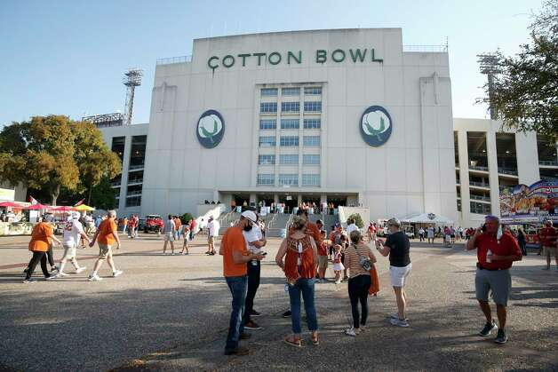 A smaller crowd, due to seating restrictions, mingles outside the Cotton Bowl prior to an NCAA college football game between the University of Texas and Oklahoma, in Dallas Saturday, Oct. 10, 2020. (AP Photo/Michael Ainsworth) Photo: Michael Ainsworth, Associated Press / Copyright 2020 The Associated Press. All rights reserved.