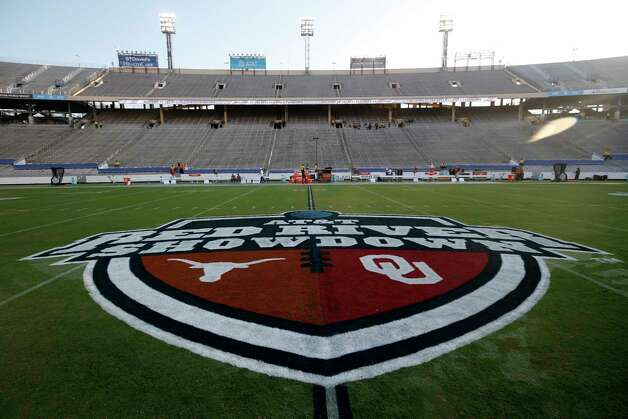 The Red River Showdown logo is shown on the field of the Cotton Bowl, prior to an NCAA college football game between the University of Texas and Oklahoma, in Dallas,  Saturday, Oct. 10, 2020. (AP Photo/Michael Ainsworth) Photo: Michael Ainsworth, Associated Press / Copyright 2020 The Associated Press. All rights reserved.