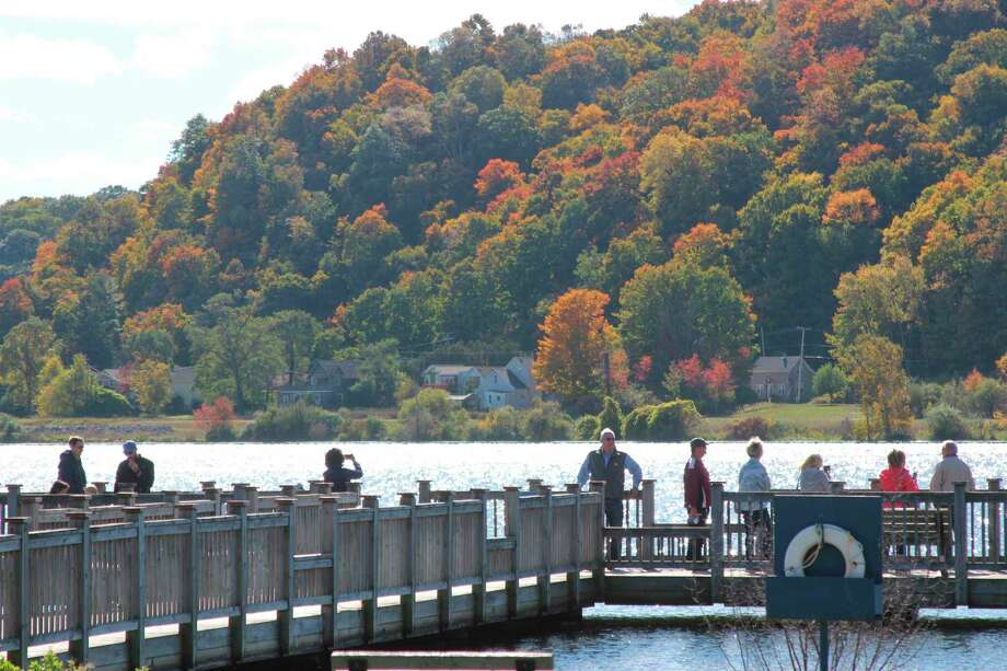 Families enjoy a view of Betsie Bay and the emerging colors on the trees across the bay in Elberta. (Photo/Colin Merry)