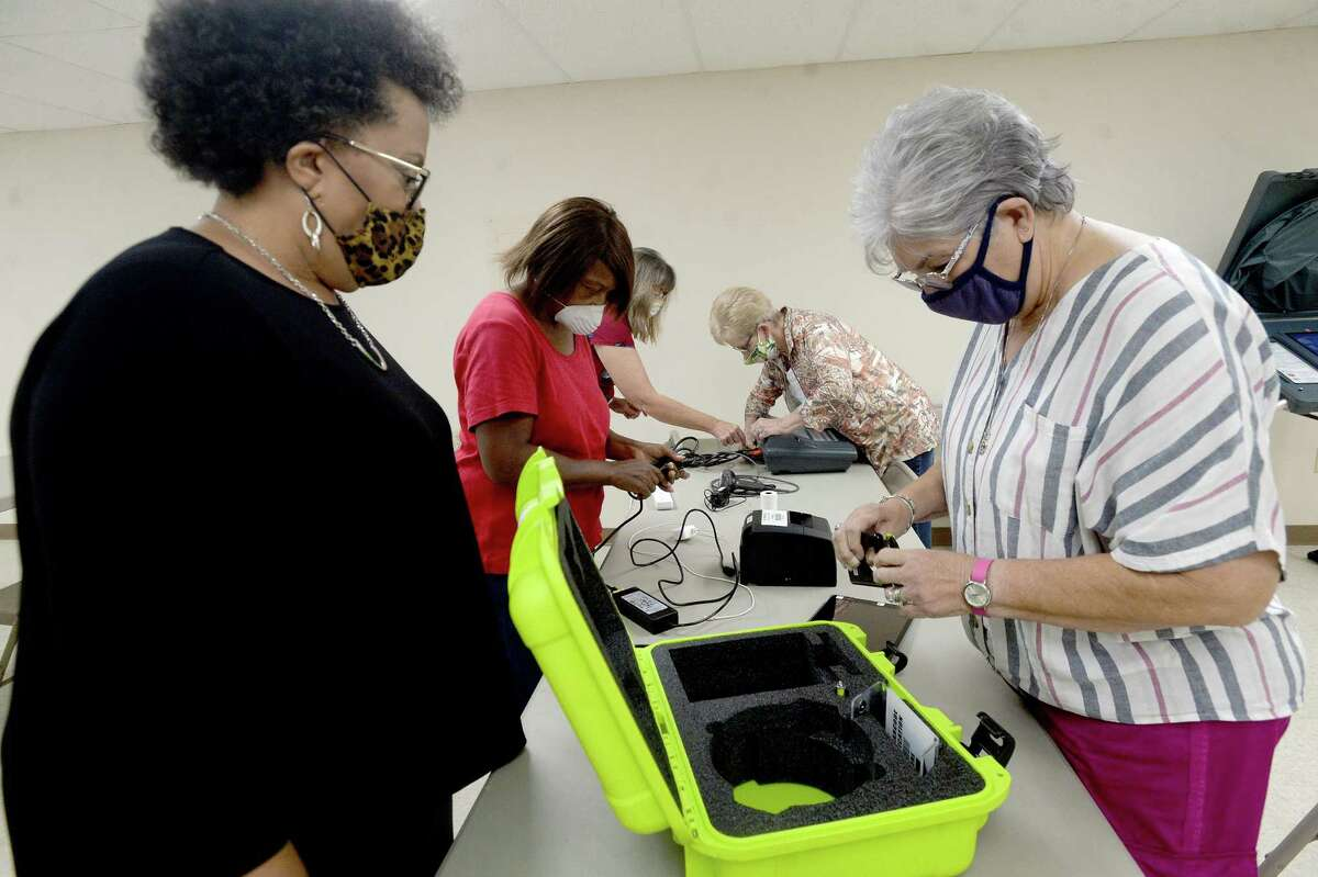 Jefferson County election worker Azzie Williams - Mills watches as Sylvia McDuffie repacks the poll pad during a training session for those working the polls in the upcoming election. Photo taken Monday, September 21, 2020 Kim Brent/The Enterprise