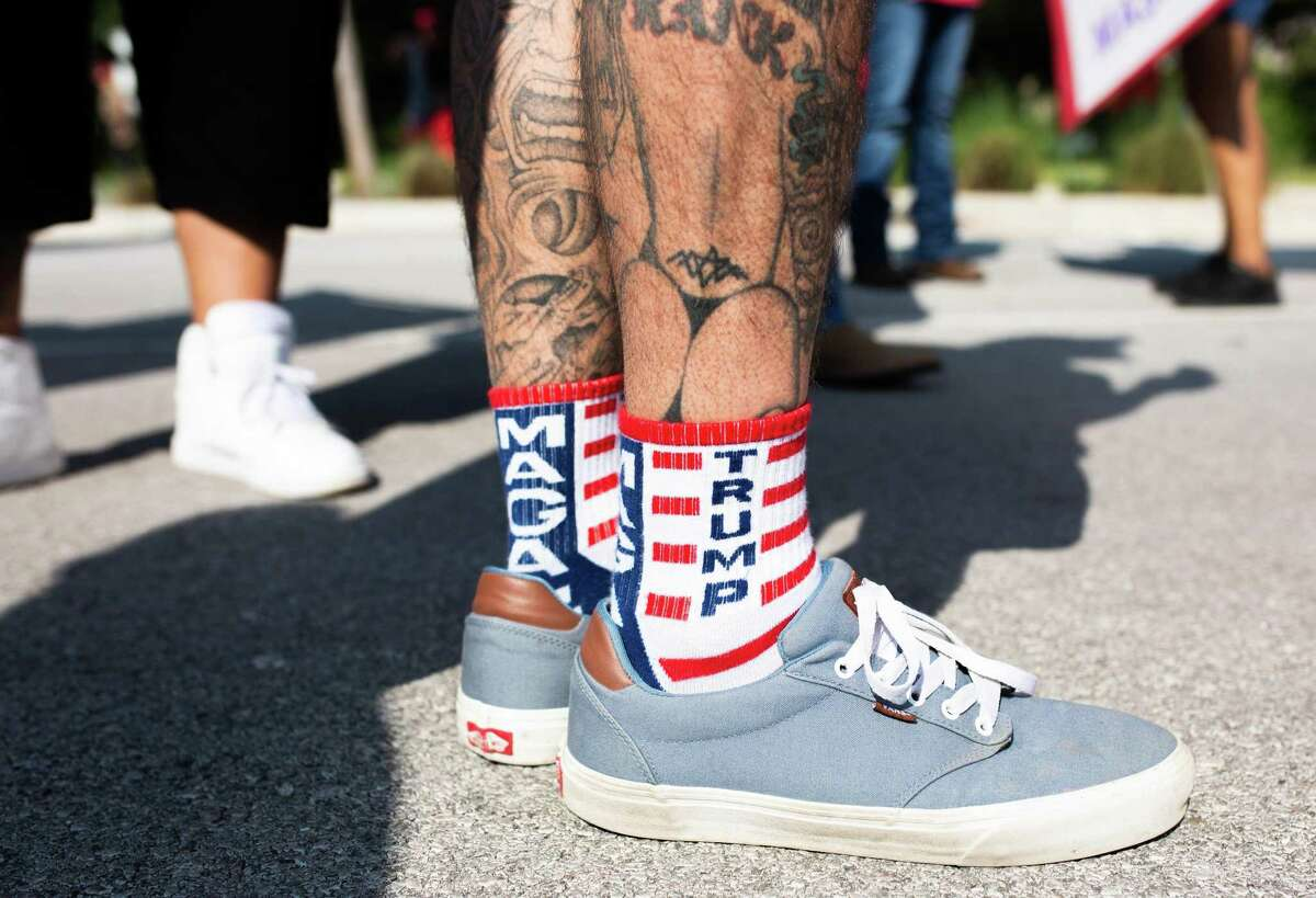 Trump flags, signs and even socks were out in support as people came out to join the protest over their disagreement with Gov. Greg Abbott handling of Covid-19 with mask mandates and business closures and restrictions at the Governor's Mansion on October 10, 2020 in Austin, Texas.