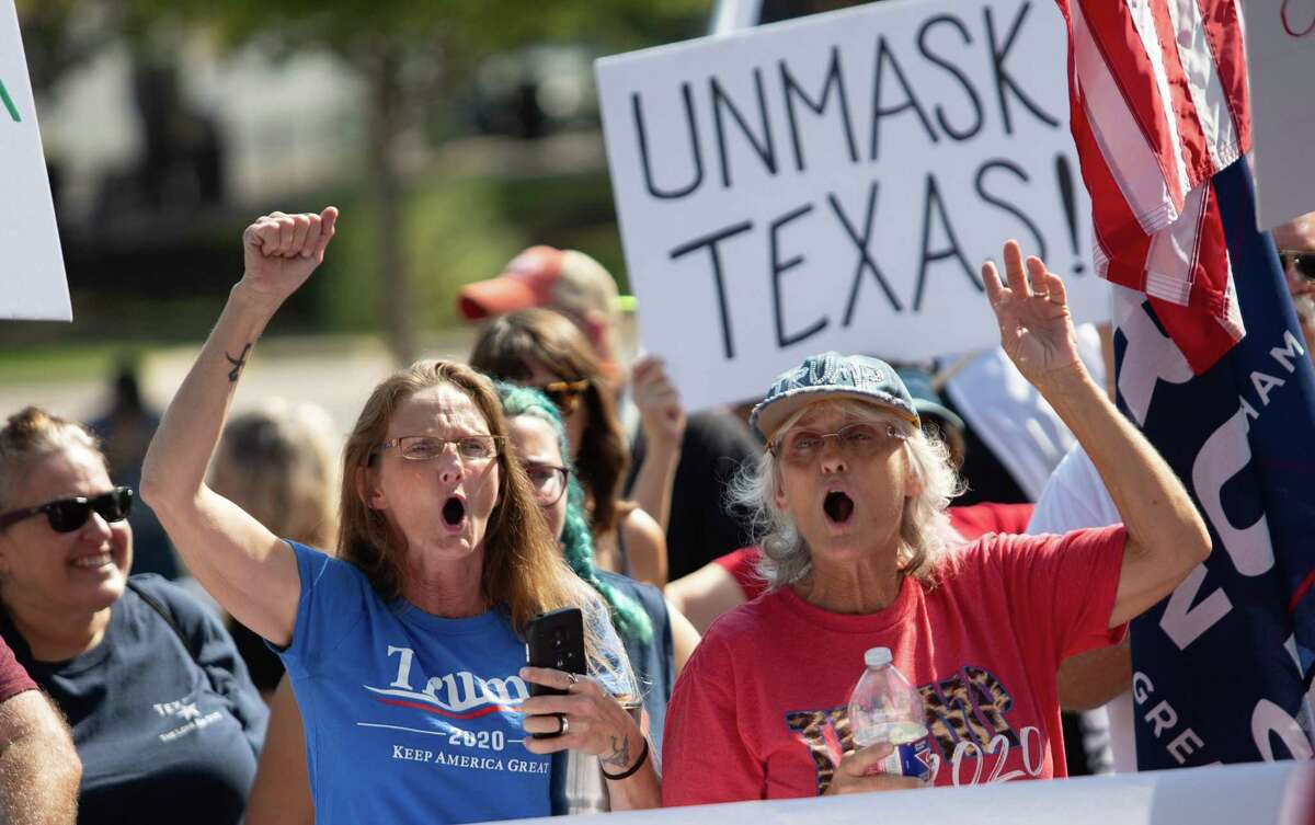 Two women who only wanted to be identified as patriots came out to join the protest over their disagreement with Gov. Greg Abbott handling of Covid-19 with mask mandates and business closures and restrictions at the Governor's Mansion on October 10, 2020 in Austin, Texas.