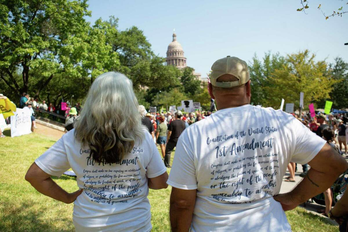 A couple celebrate the First Amendment at a rally in Austin last week. Political factions give greater voice to people and serve as checks.