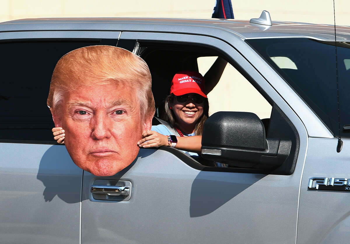 Supporters of President Trump head down Victoria Street, Saturday, Oct. 10, 2020, as they begin the second Trump Train through Laredo.
