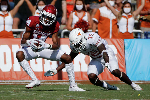 Oklahoma wide receiver Charleston Rambo (14) catches a pass in front of Texas defensive back Chris Brown (15) during an NCAA college football game in Dallas, Saturday, Oct. 10, 2020. (AP Photo/Michael Ainsworth) Photo: Michael Ainsworth, Associated Press / Copyright 2020 The Associated Press. All rights reserved.