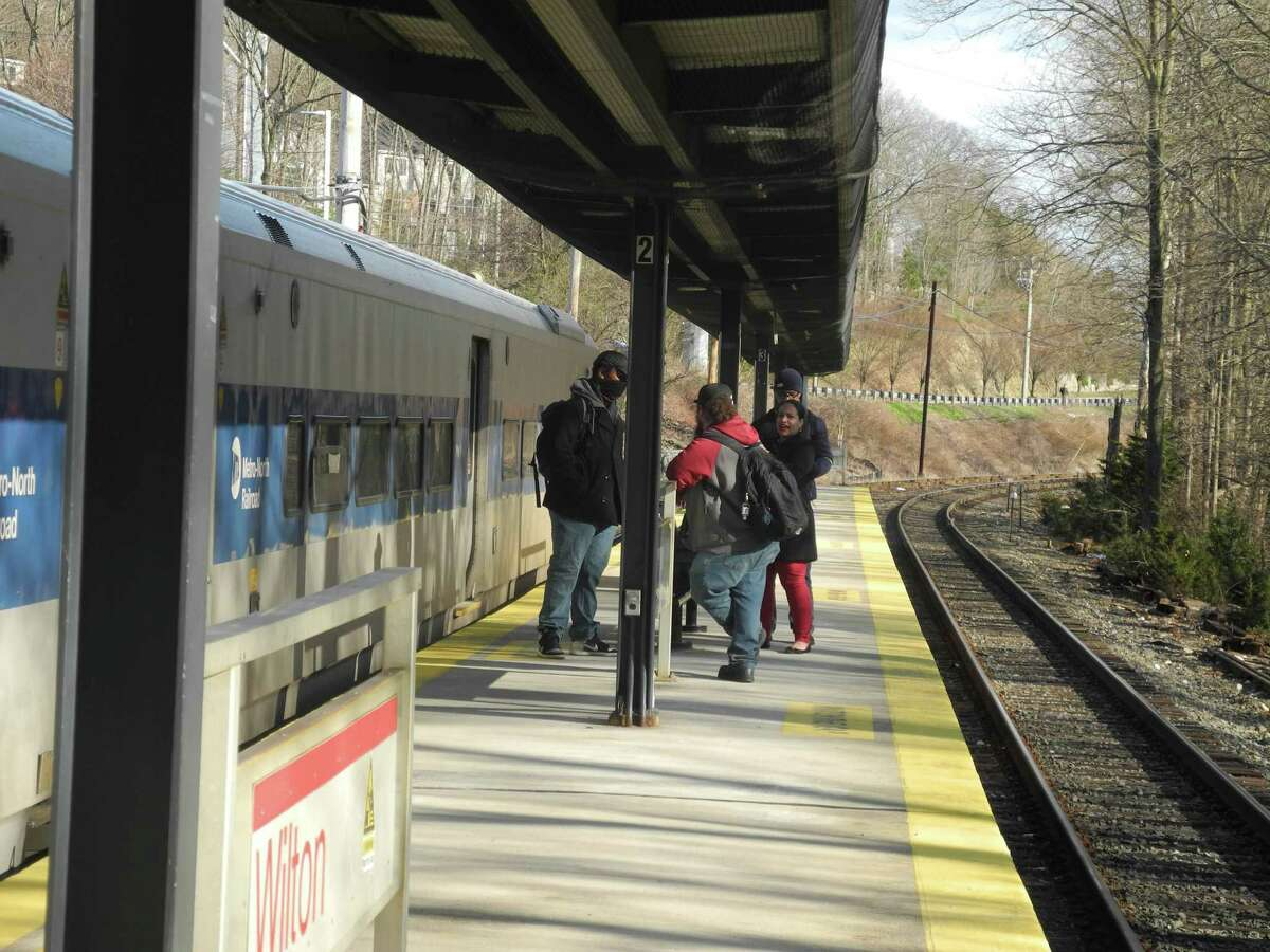 Four Stop & Shop employees are the only people to board the 5:06 train to South Norwalk last Wednesday afternoon. Alfredo Gonzalez says he is usually alone when he rides the train.