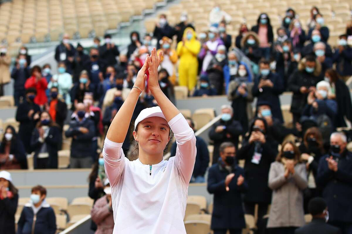 PARIS, FRANCE - OCTOBER 10: Iga Swiatek of Poland celebrates after winning championship point during her Women's Singles Final against Sofia Kenin of The United States of America on day fourteen of the 2020 French Open at Roland Garros on October 10, 2020 in Paris, France. (Photo by Julian Finney/Getty Images)