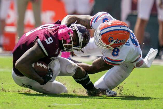 Florida wide receiver Trevon Grimes (8) brings down Texas A&M defensive back Leon O'Neal Jr. (9) after an interception that was called back due to a penalty during the second half of an NCAA college football game, Saturday, Oct. 10, 2020. in College Station, Texas. (AP Photo/Sam Craft) Photo: Sam Craft, Associated Press / Copyright 2020 The Associated Press. All rights reserved.