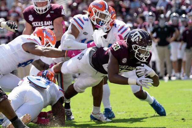 Texas A&M running back Isaiah Spiller (28) dives over the goal line for a touchdown against Florida during the second half of an NCAA college football game, Saturday, Oct. 10, 2020. in College Station, Texas. (AP Photo/Sam Craft) Photo: Sam Craft, Associated Press / Copyright 2020 The Associated Press. All rights reserved.