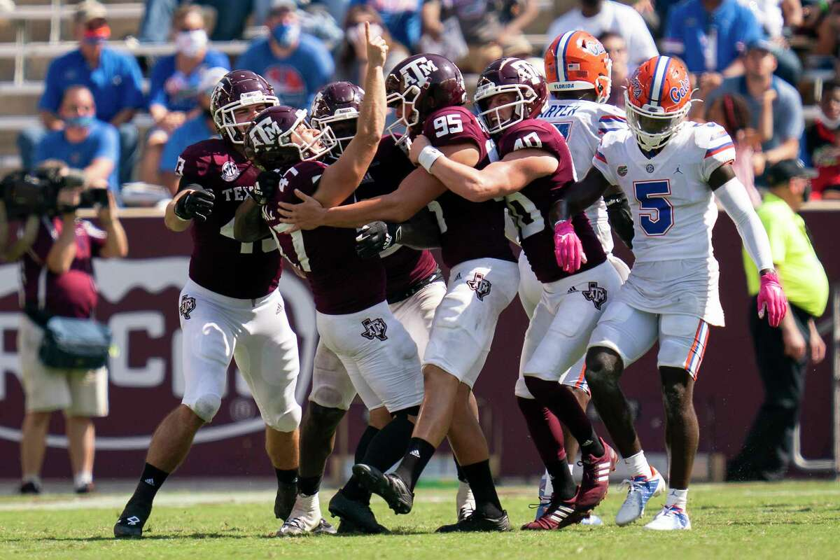 Texas A&M place kicker Seth Small (47) reacts with teammates after making the game winning field goal against Florida as time expired of an NCAA college football game, Saturday, Oct. 10, 2020. in College Station, Texas. (AP Photo/Sam Craft)