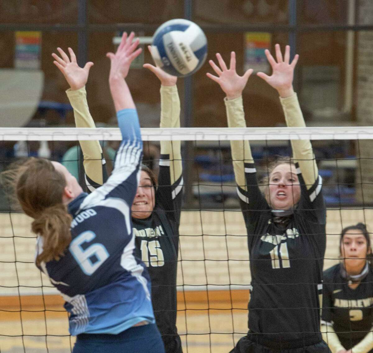 Andrews' Laura Madrilez and Tori Woodside go up for the block as Greenwood's Edie Coleman goes for a hit 10/10/2020 at Greenwood High gym. Tim Fischer/Reporter-Telegram