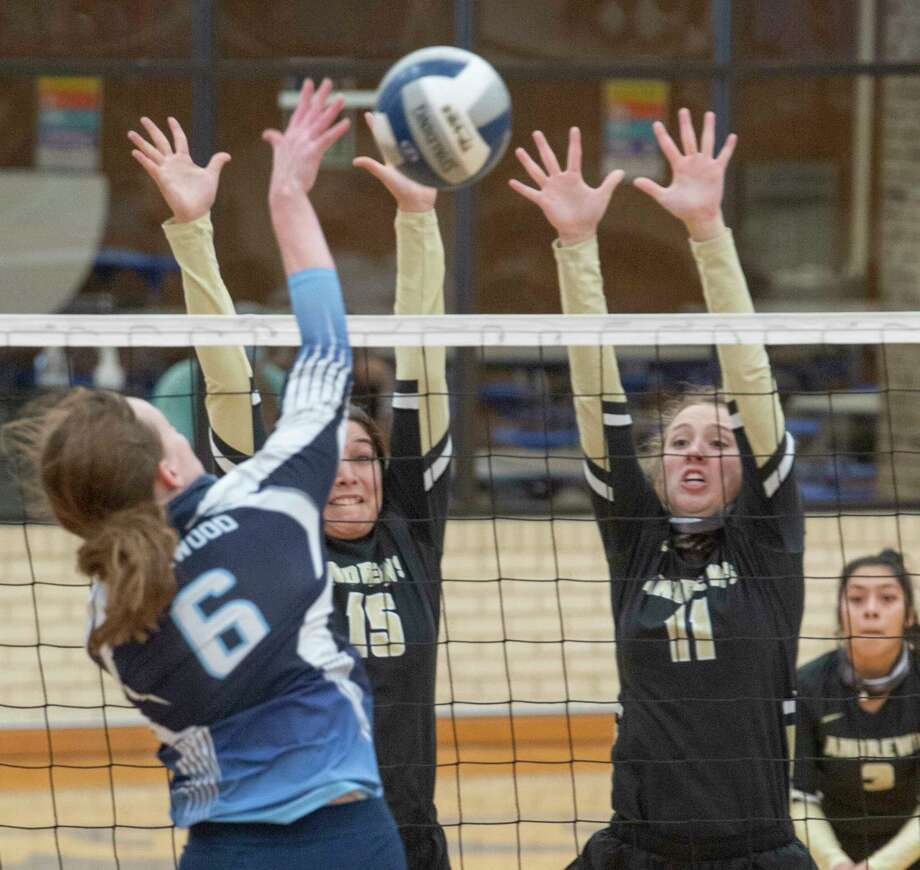 Andrews' Laura Madrilez and Tori Woodside go up for the block as Greenwood's Edie Coleman goes for a hit 10/10/2020 at Greenwood High gym. Tim Fischer/Reporter-Telegram Photo: Tim Fischer, Midland Reporter-Telegram