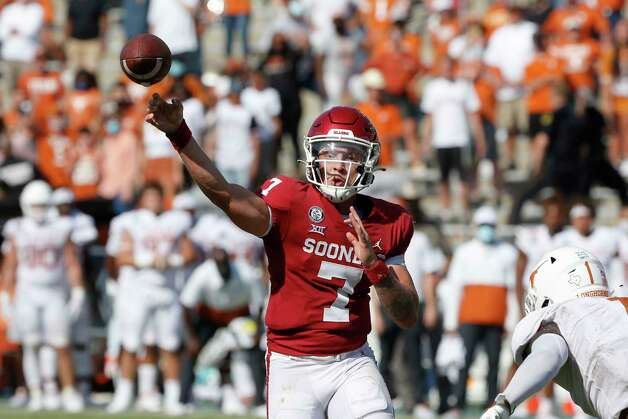Oklahoma quarterback Spencer Rattler (7) throws a pass on a 2-point conversion against Texas during the fourth overtime of NCAA college football game in Dallas, Saturday, Oct. 10, 2020. Oklahoma defeated Texas 53-45 in four overtimes. (AP Photo/Michael Ainsworth) Photo: Michael Ainsworth, Associated Press / Copyright 2020 The Associated Press. All rights reserved.