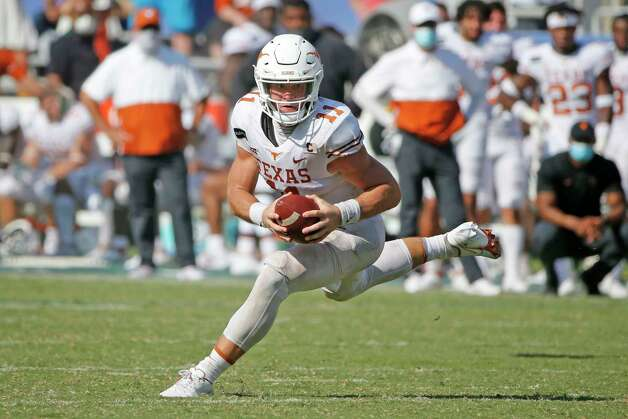Texas quarterback Sam Ehlinger scrambles during the second half of the team's NCAA college football game against Oklahoma in Dallas, Saturday, Oct. 10, 2020. Oklahoma won 53-45 in four overtimes.(AP Photo/Michael Ainsworth) Photo: Michael Ainsworth, Associated Press / Copyright 2020 The Associated Press. All rights reserved.