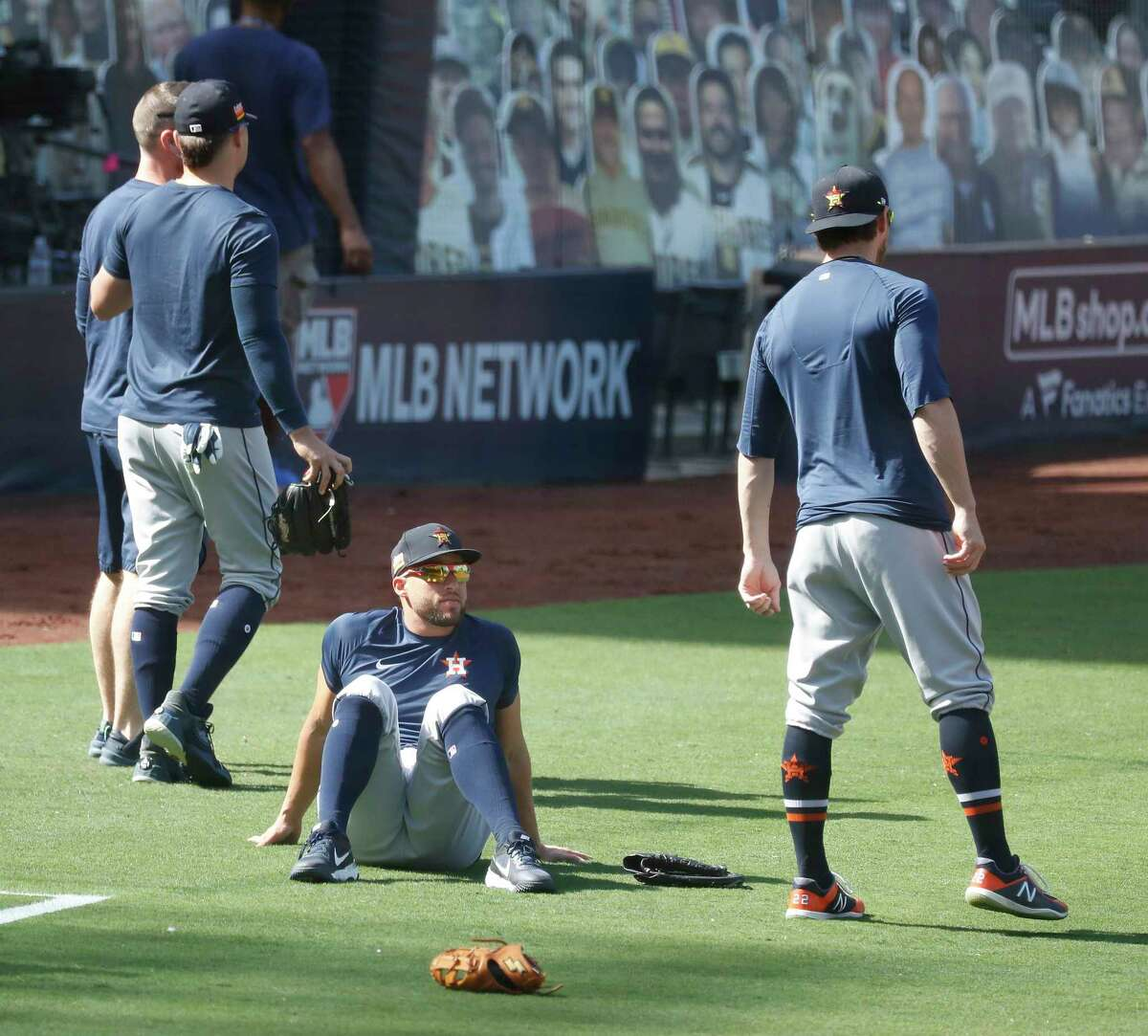Houston Astros George Springer sits on the ground during workouts at Petco Park, Saturday, October 10, 2020, in San Diego, as the Astros prepare for the 2020 American League Championship Series against the Tampa Bay Rays starting Sunday.
